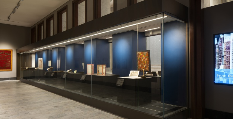 View of the 46-foot-long display case running the length of the From the Stacks exhibit.