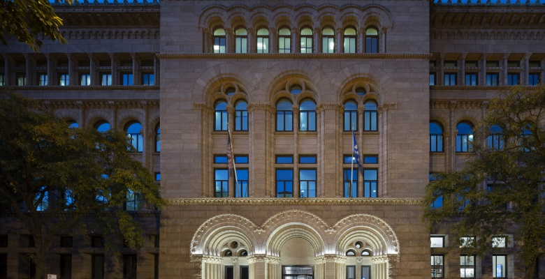 New lighting designed by Schuler Shook illuminates the architectural details of the Newberry facade while expressing a more welcoming personality to the neighborhood.