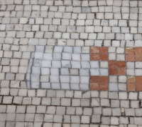 Worn patches of our original mosaic flooring in the lobby are being restored, one piece of tile (or tesserae) at a time.