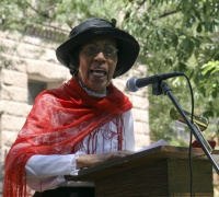 Actress Alma Washington, in the role of Lucy Parsons.