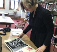 2019 Fellow Jessica Herzogenrath examines an item in the special collections reading room.
