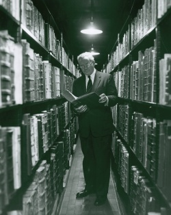 Newberry Librarian Stanley Pargellis in the stacks, ca. 1959.