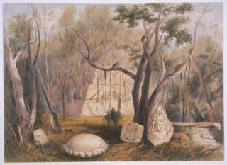 Plate II. Jungle scene featuring terraced pyramid-shaped structure made of stone bricks. It is overgrown with trees. In the foreground, several sculptured stone ornaments: a monkey skull, the busts of a warrior and a chieftain, and sacrificial stone.