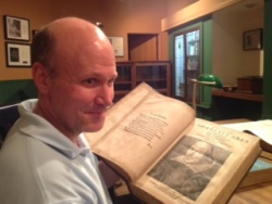 Todd Bauer with Shakespeare's First Folio
