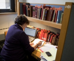 A fellow at work in her carrel