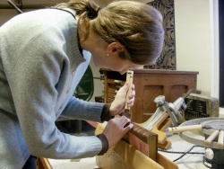 A conservation intern working on book binding.
