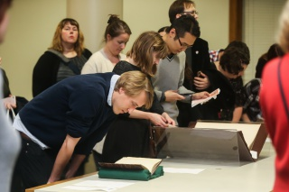 """Next Chapter members view a special presentation of collection items during a """"Forbidden Newberr"""" program."""